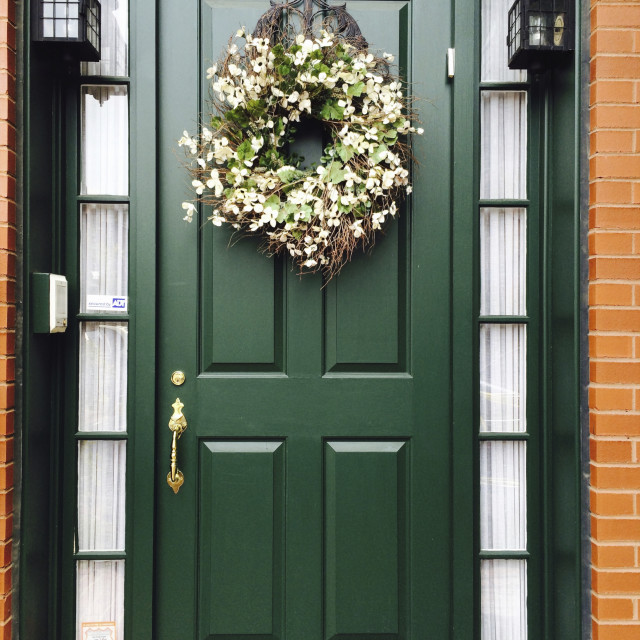 """Green door with floral wreath, outside."" stock image"