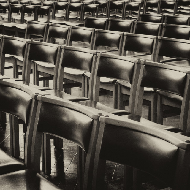 """Rows and Rows of Empty Chairs (black and white)"" stock image"