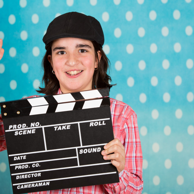 """Teenage girl with a film clapperboard"" stock image"