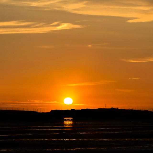 """Hilbre Island Sunset Silhouette"" stock image"