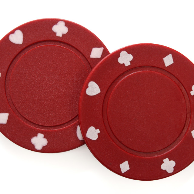 """Pair of gambling chips over white background"" stock image"