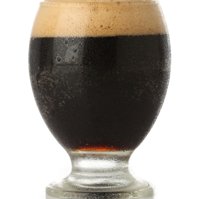 """Cold Stout beer glass isolated"" stock image"