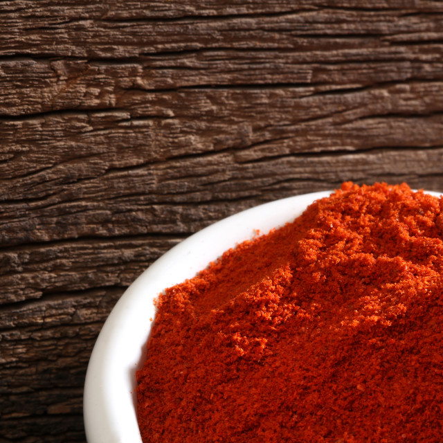"""""""Bowl with paprika over a wooden background"""" stock image"""