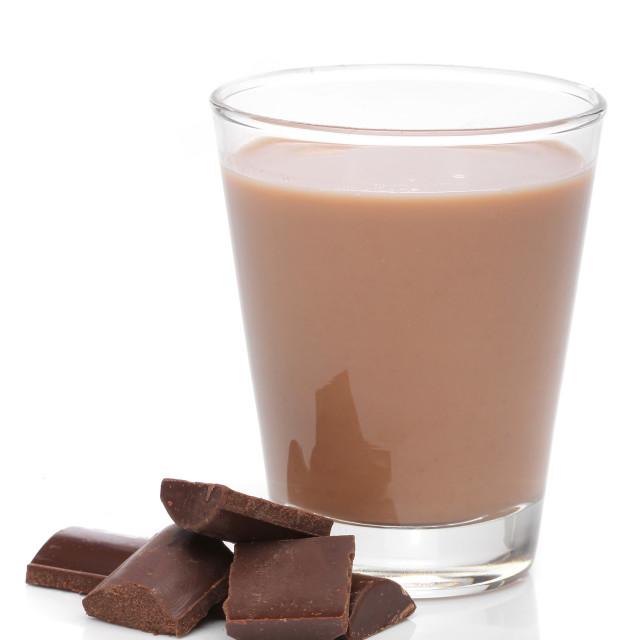 """Glass of chocolate milk with broken chocolate bars"" stock image"