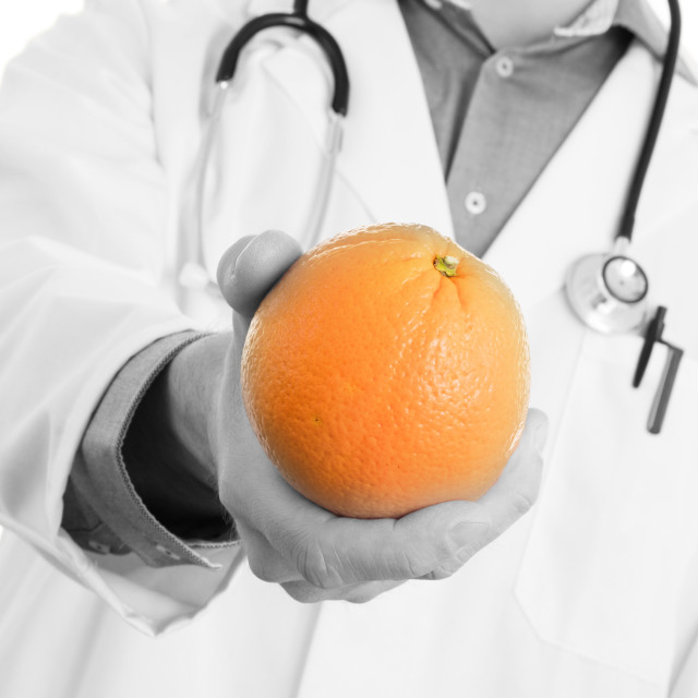 """Nutritionist doctor, giving an orange, isolated"" stock image"