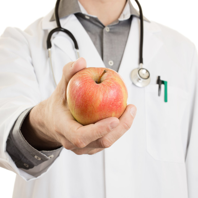 """Nutritionist doctor, giving an apple, isolated"" stock image"