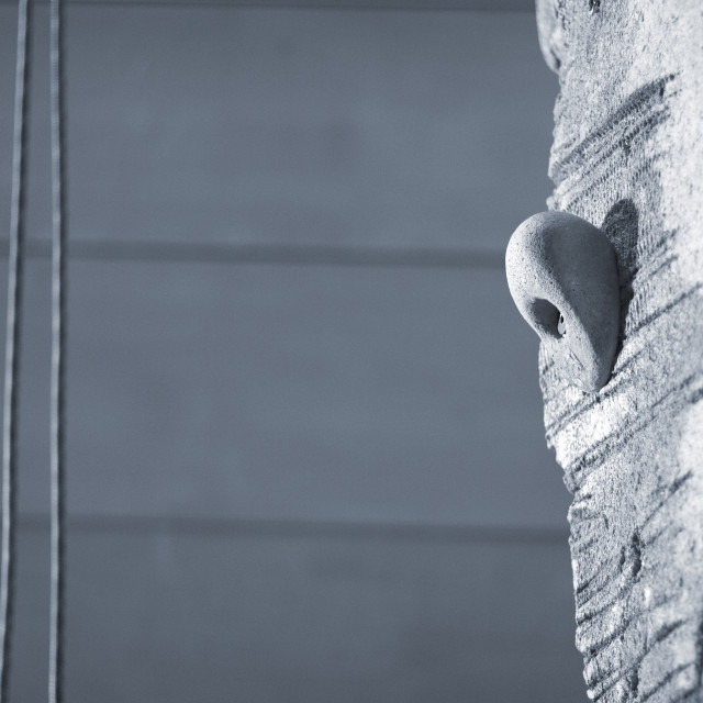 """Indoor climbing wall ropes"" stock image"