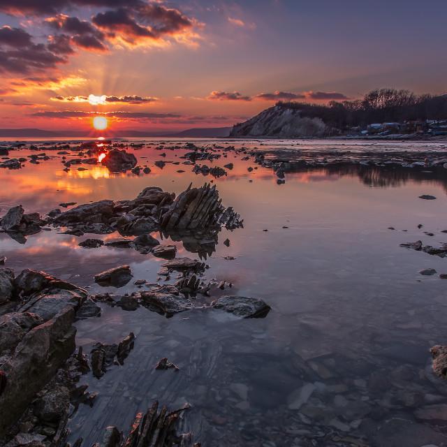"""Sea rocks at sunset."" stock image"