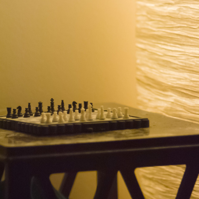 """old chess set on old table"" stock image"