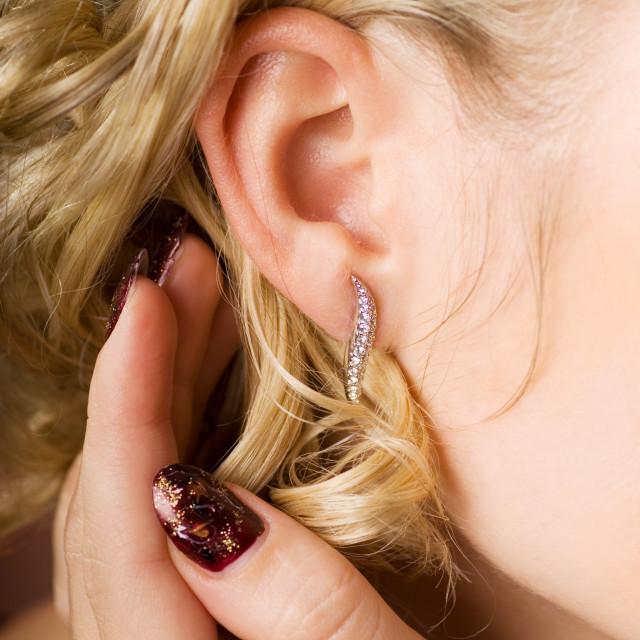 """Woman's ear with diamond jewlery"" stock image"