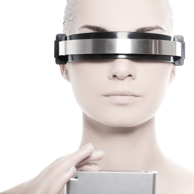 """""""Cyber woman holding silver gadget"""" stock image"""
