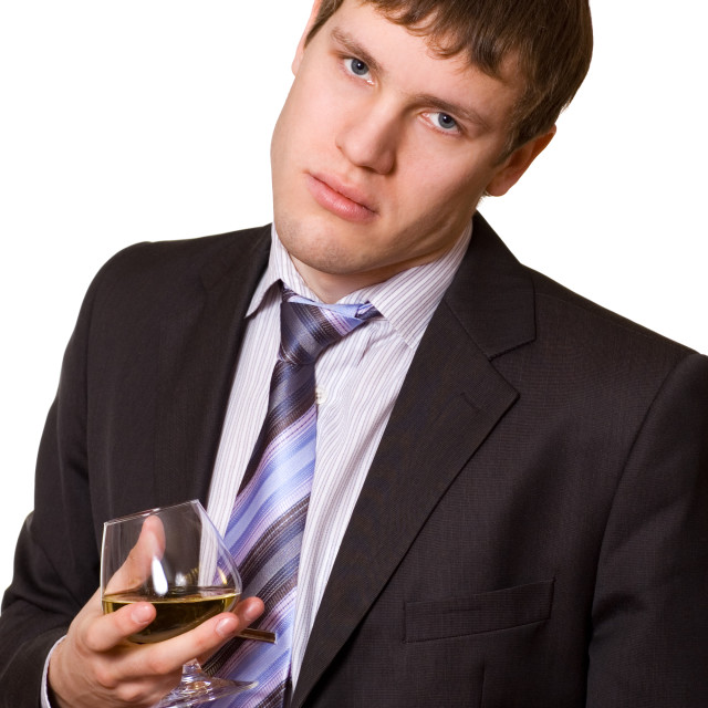 """Tired business man with a glass of cognac"" stock image"