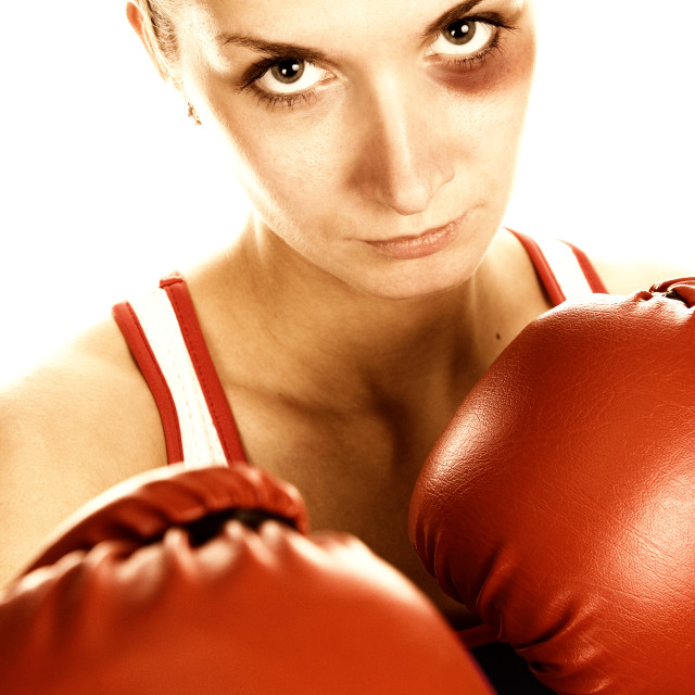 """""""Sepia picture of a woman boxer with a bruise on her face"""" stock image"""