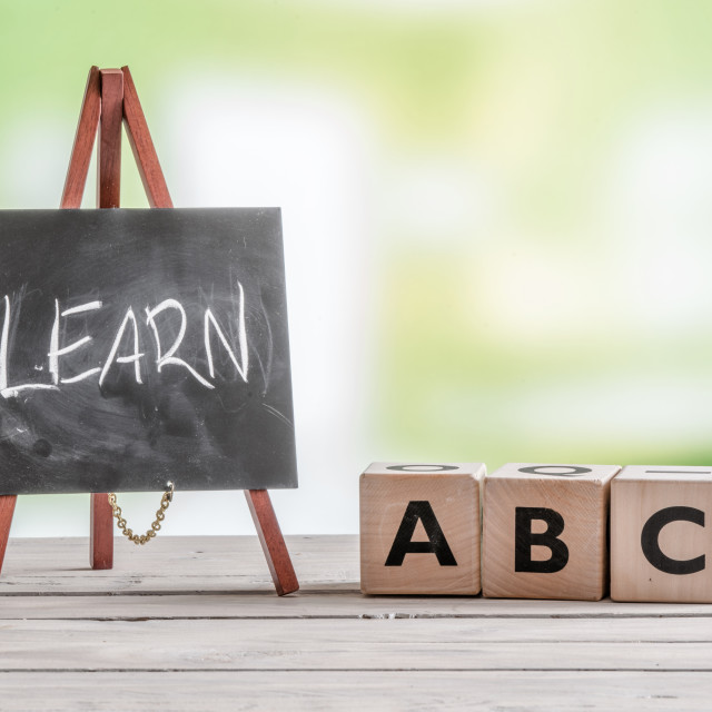"""Blackboard and cubes with alphabet"" stock image"