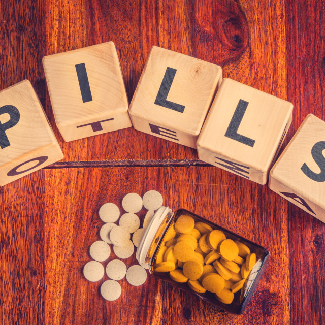 """The word pills on a table"" stock image"
