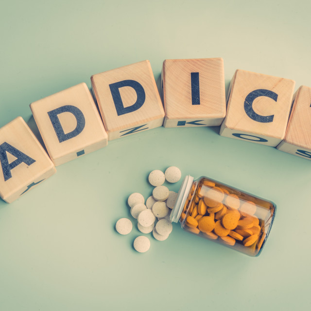 """The word addict on a table"" stock image"