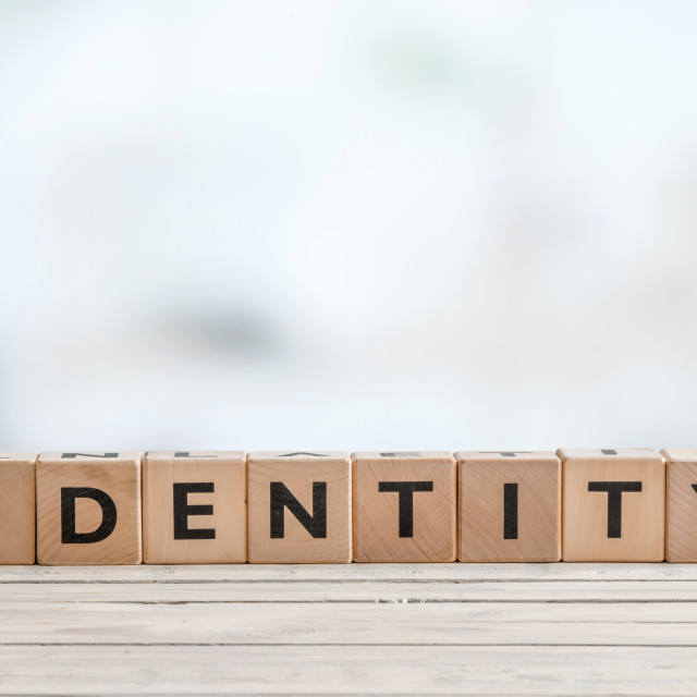 """Identity sign on wooden table"" stock image"