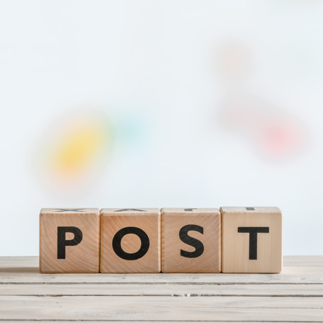 """""""Post sign on a wooden table"""" stock image"""