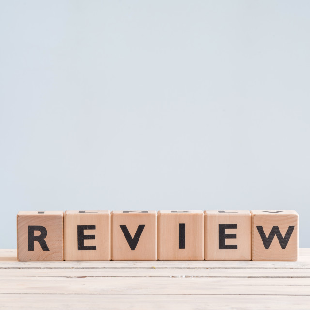 """Review sign on a table"" stock image"