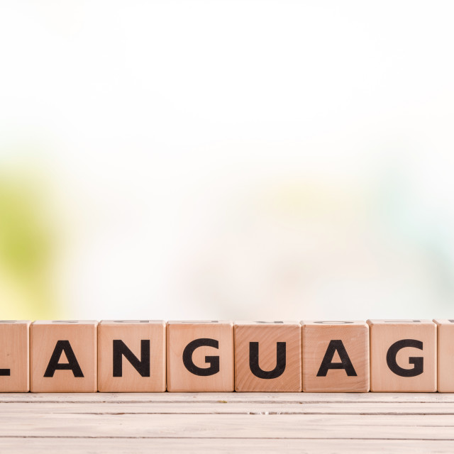 """""""Language lesson sign on a table"""" stock image"""
