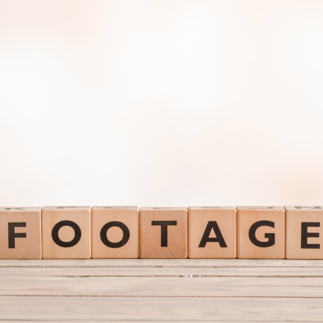 """Footage sign made of wooden cubes"" stock image"