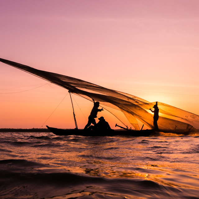 """People try to hold the fishing net in the sunset"" stock image"