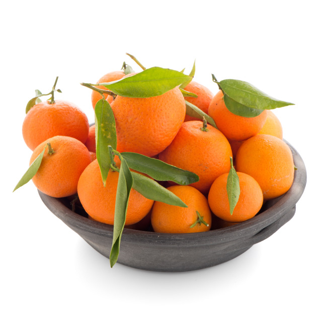 """Tangerines on clay bowl"" stock image"