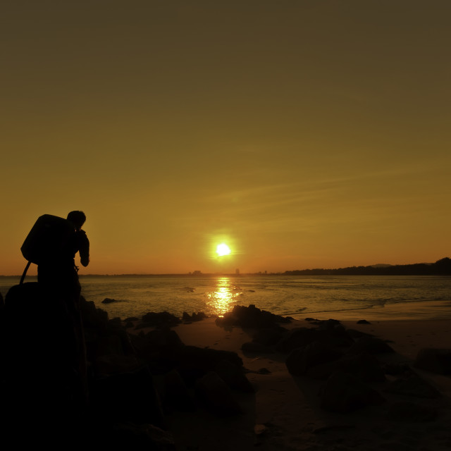 """""""Silhouette of photography at Sunset"""" stock image"""