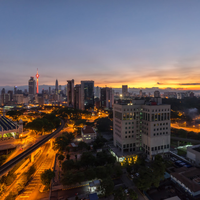 """Sun ray at Kuala Lumpur city skyline"" stock image"