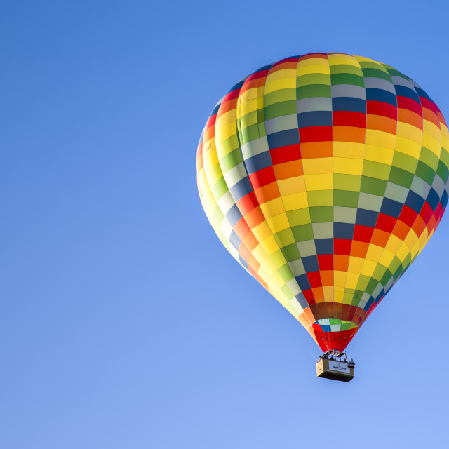 """Multicolored Hot Air Balloon in Blue Sky"" stock image"
