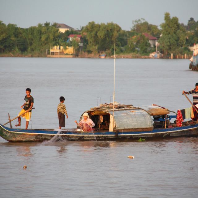 """""""Family fishing at dusk"""" stock image"""
