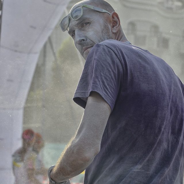 """""""Man who is a staff member of the Color run of Rimini."""" stock image"""