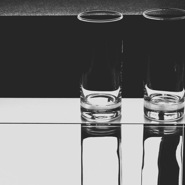 """""""Glasses on a table BW"""" stock image"""