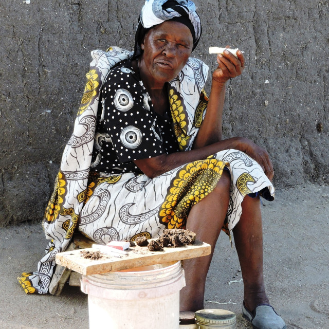 """""""The Old Lady Tobacco Seller in Lake Victoria fishing village"""" stock image"""