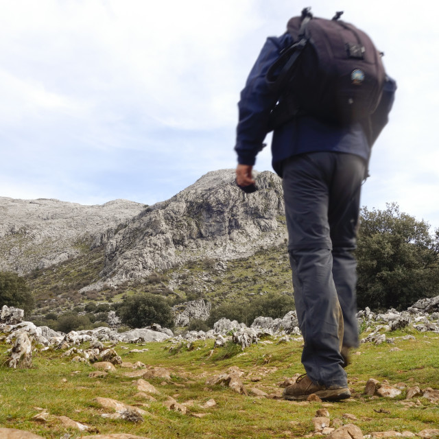 """""""Hiker on trail in mountains"""" stock image"""