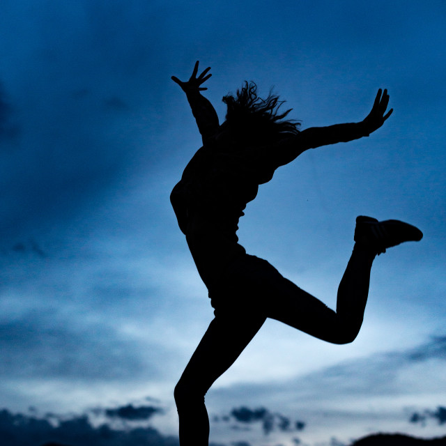 """You can jump over a mountain only after the sunset..."" stock image"