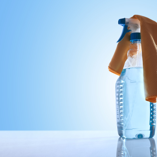 """Bottle with glass cleaner and a rag"" stock image"