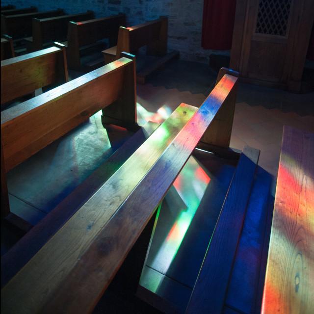 """Light on Church Pews"" stock image"