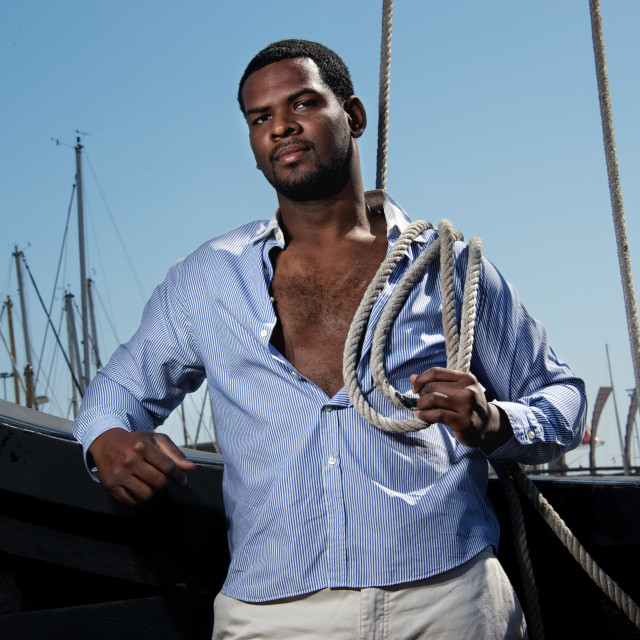 """""""Handsome afro-american sailor against boats."""" stock image"""
