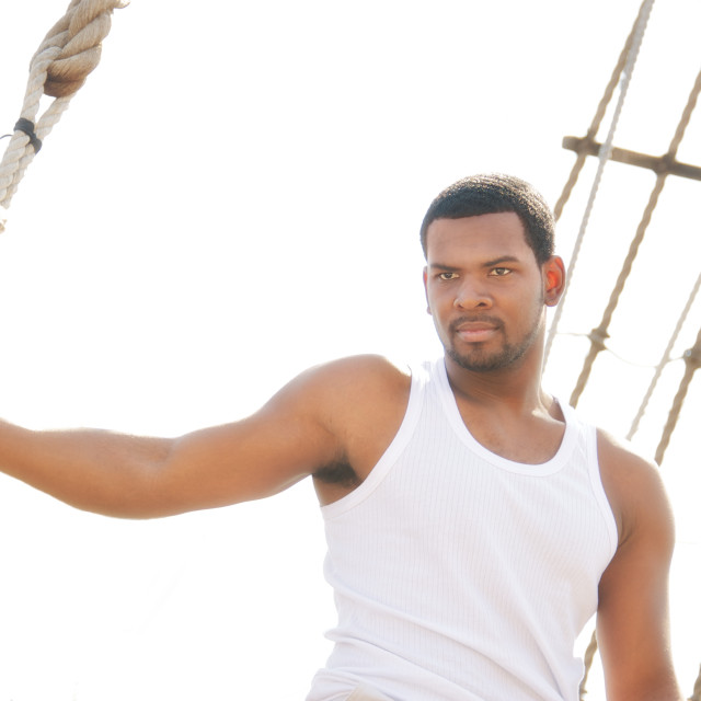 """""""Handsome afro-american man on boat's deck."""" stock image"""