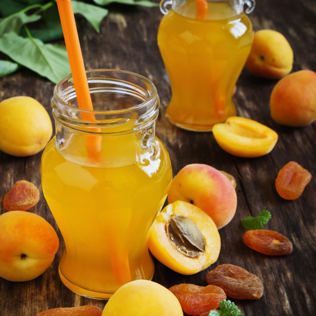 """""""apricot juice in small jars"""" stock image"""