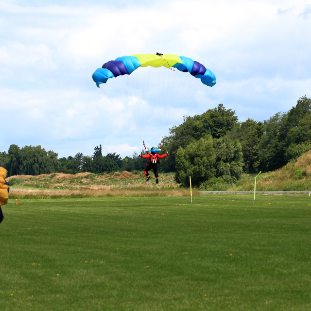 """""""Skydiver in process of landing after the jump in formation."""" stock image"""