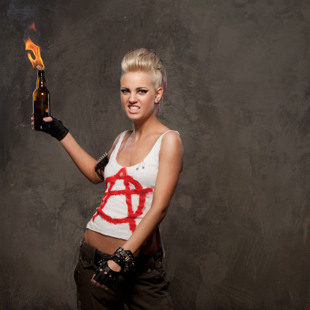 """Punk girl with a Molotov cocktail."" stock image"