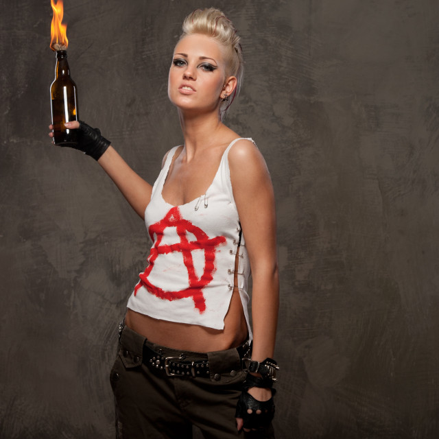 """Punk girl with a Molotov cocktail"" stock image"