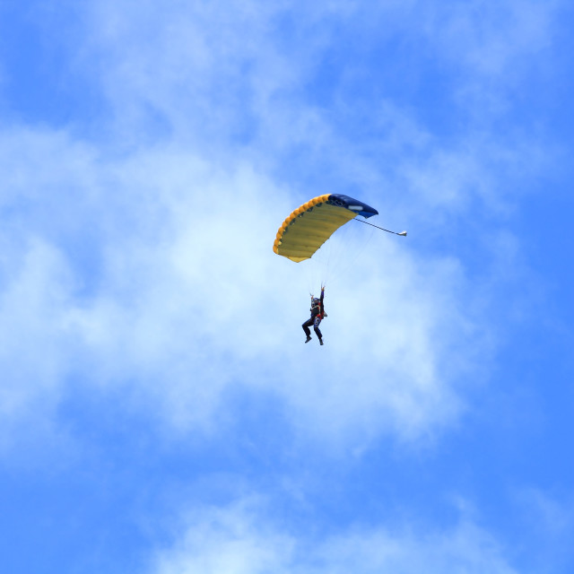 """""""Skydiver parachuting down to the Earth."""" stock image"""