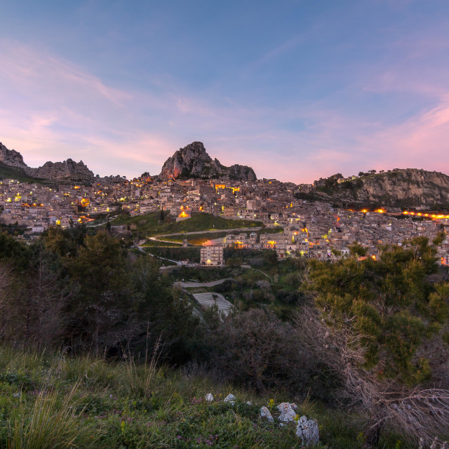 """Italian beautiful Sicilian town on a mountain at sunset."" stock image"