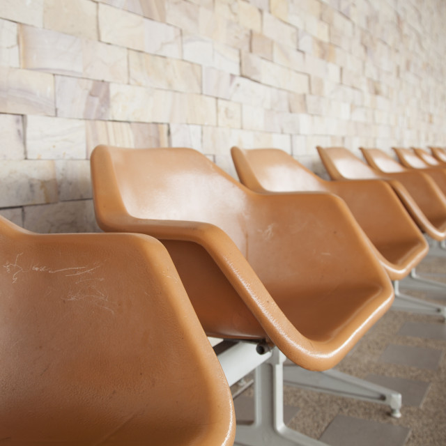 """Orange plastic chair"" stock image"