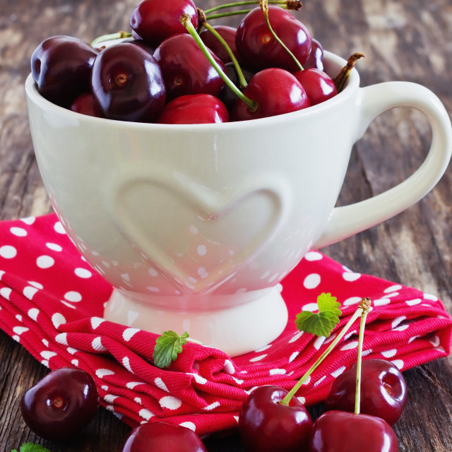 """ripe cherries in a mug with a heart"" stock image"
