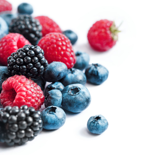 """Mix of fresh berries on white background."" stock image"