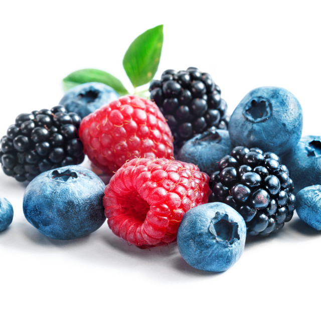 """Blueberries, raspberries and blackberries on white background."" stock image"